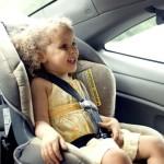 child in car seat - publicdomain