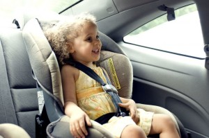 child in car seat - publicdomain